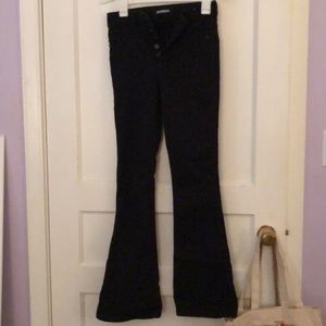 high-waisted black boot-cut jeans